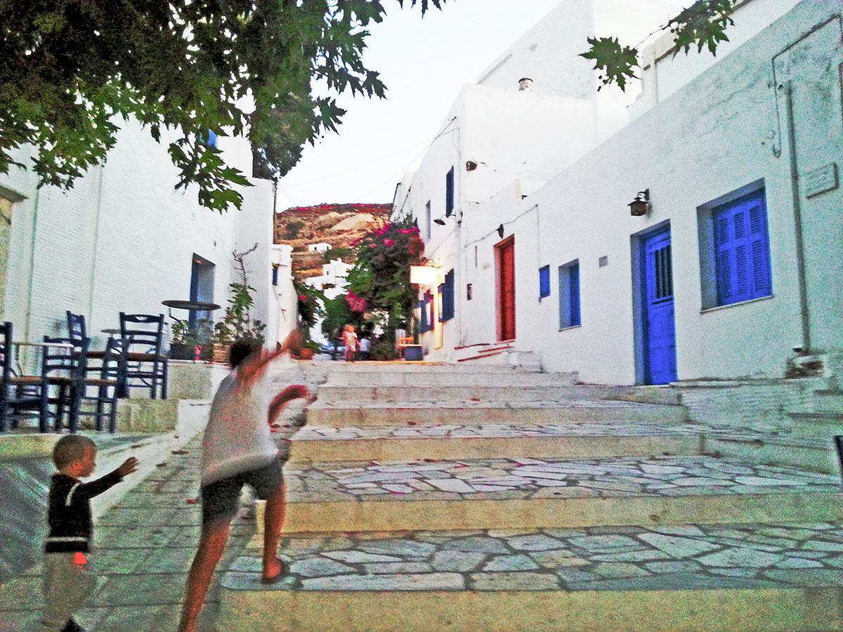 tinos-greek-island-beaches-tourism-pyrgos-village-playing-children
